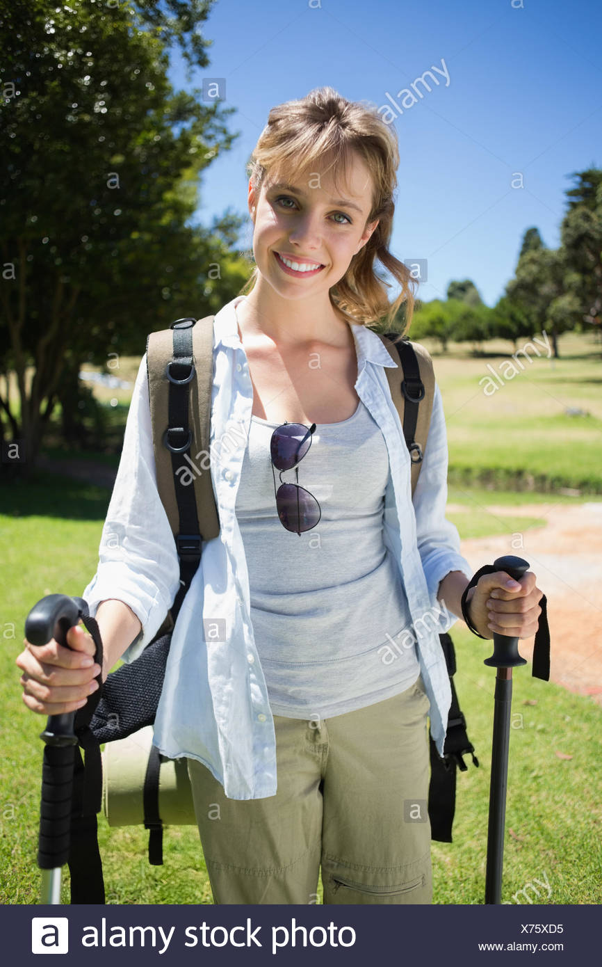 Fit smiling woman going for a hike - Stock Image