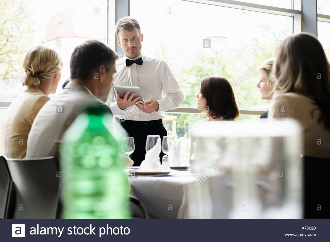 Waiter taking order with tablet computer - Stock Image