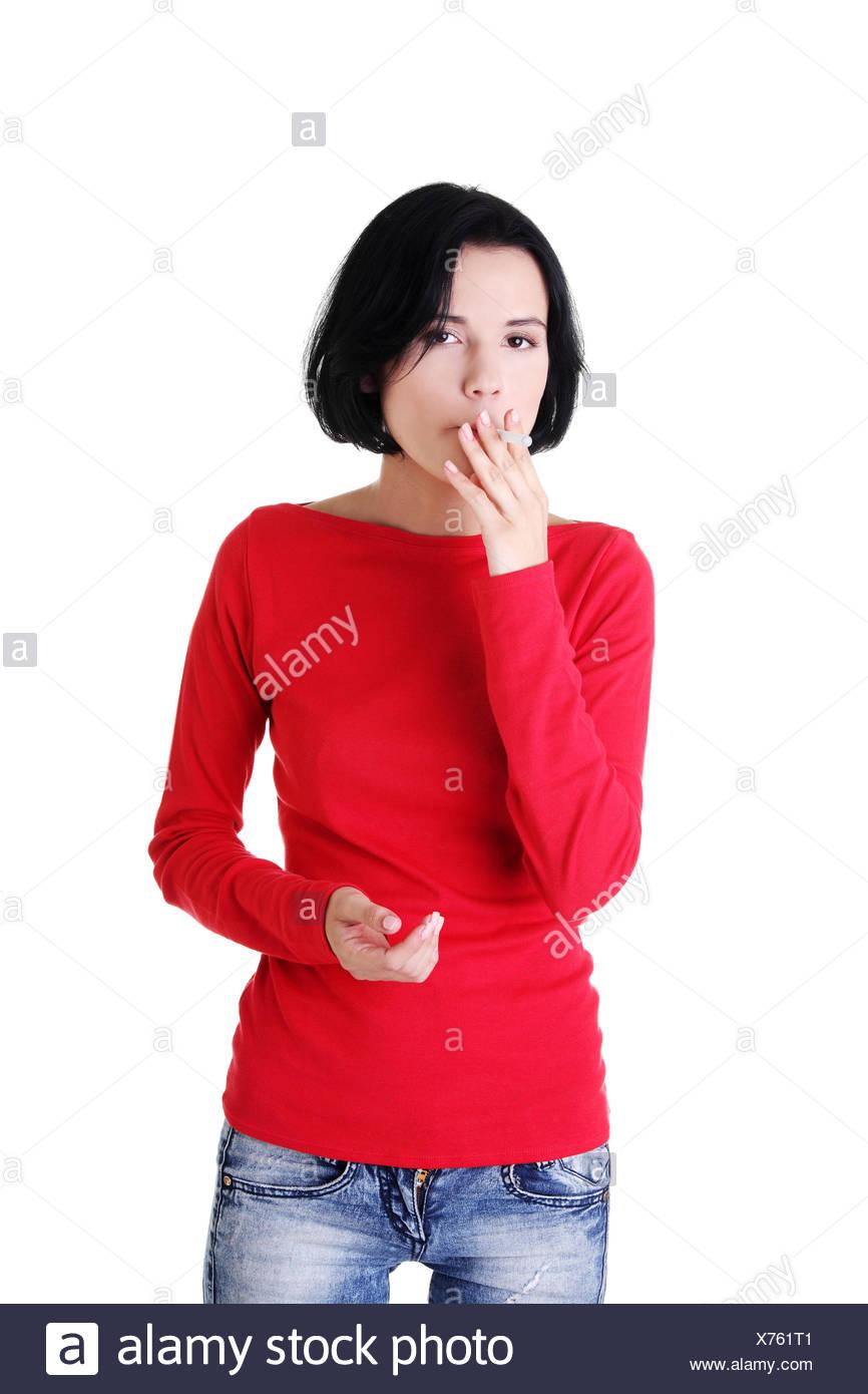 Young woman smoking electronic cigarette - Stock Image