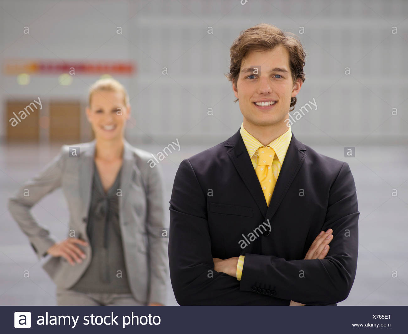 Businesspeople posing suits - Stock Image