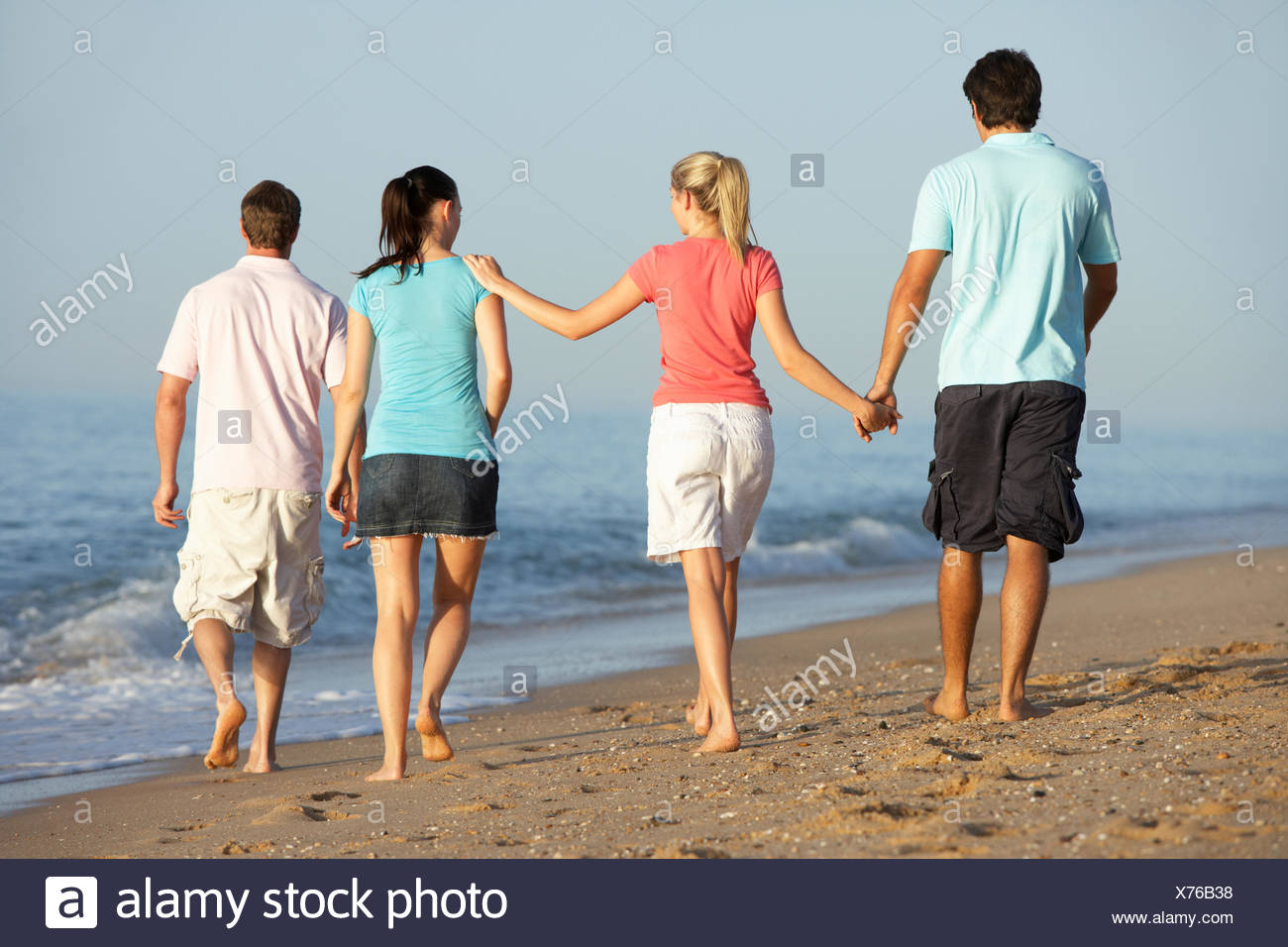 woman,walk,walking,beach,Lifestyle,Caucasian,Female,twenties,20s,outdoors,beach,enjoying,relaxed,relaxing,holiday,vacation,full Length,people,person,vertical,happy,smiling,woman,seaside,ocean,holiday,vacation,shore,shoreline,sandy,looking,copy space - Stock Image