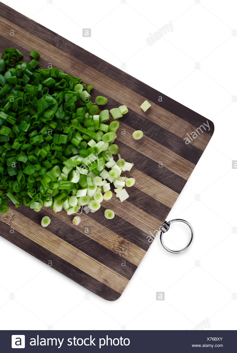 Green chopped onions on a cutting board Stock Photo