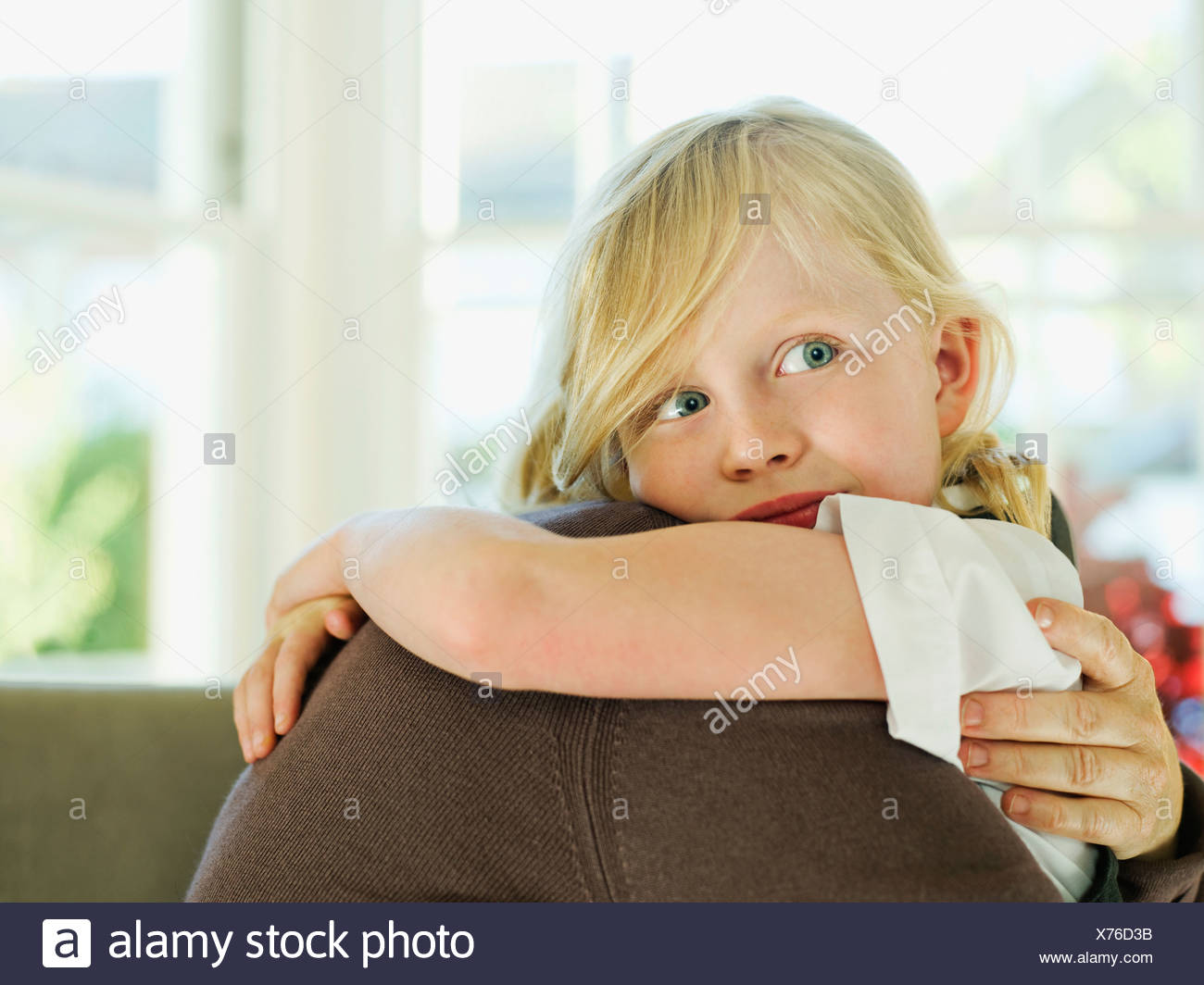 A little girl hugging a loved one Stock Photo