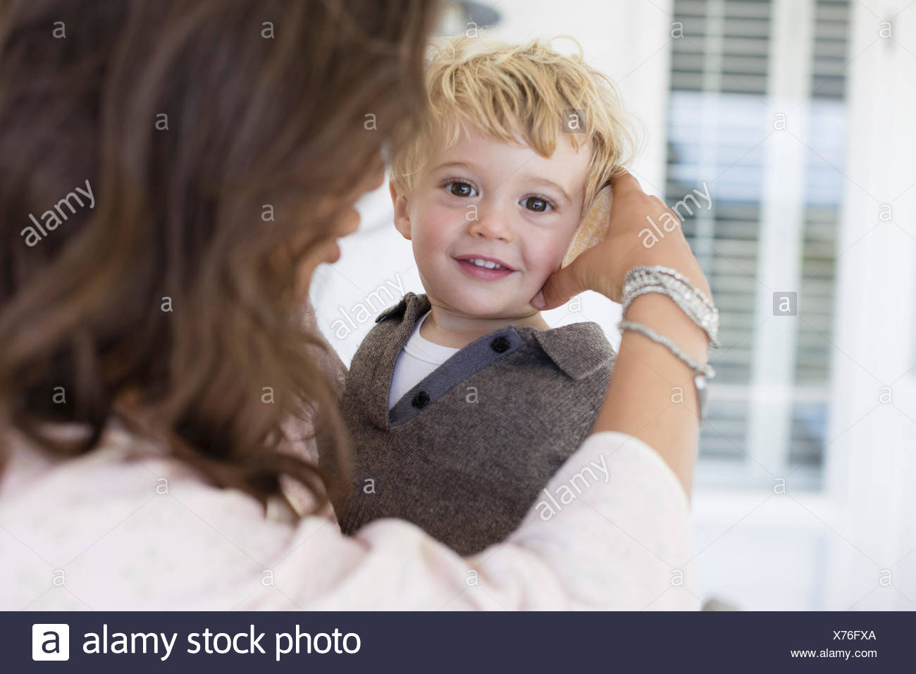 Mother playing with son at home Stock Photo