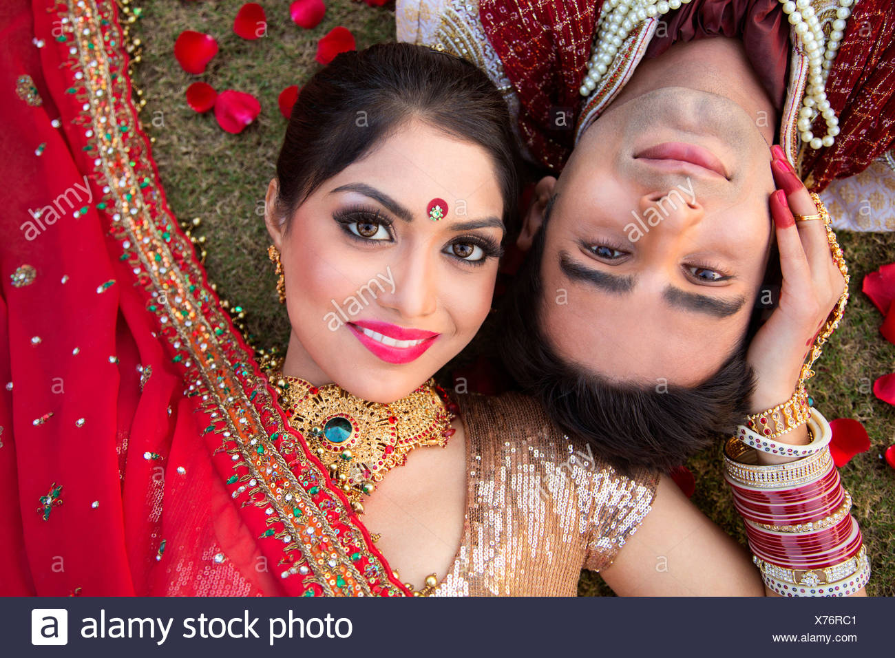 Indian bride and groom in traditional wedding dress and posing Stock ...