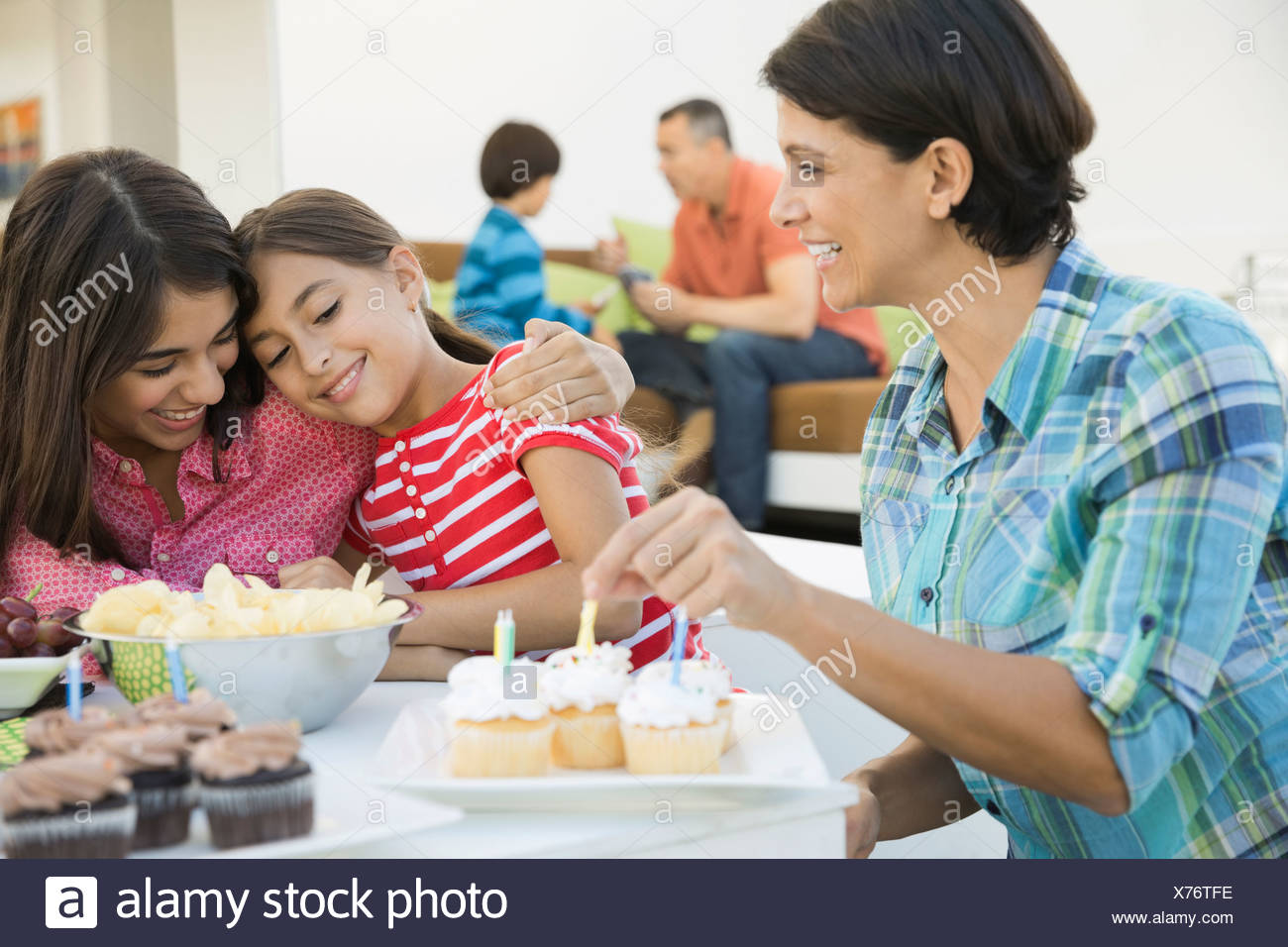 Family celebrating girls birthday - Stock Image