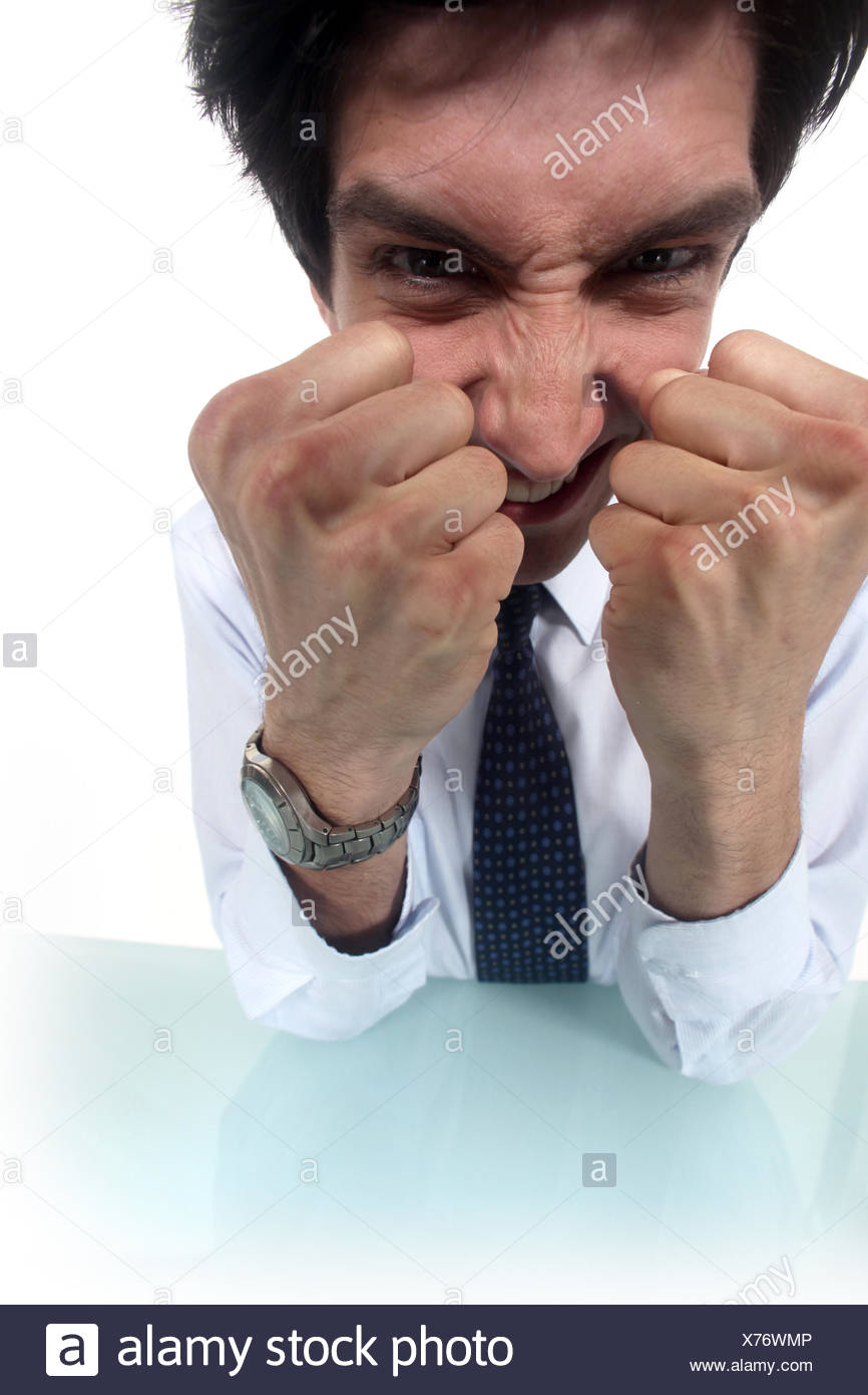 Frustrated businessman clenching his fists Stock Photo