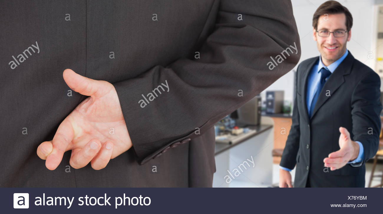 Composite image of businessman with fingers crossed - Stock Image