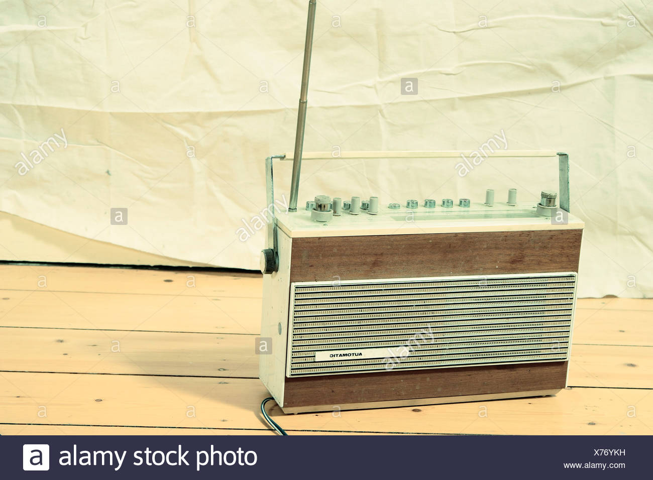Radio on wooden floor - Stock Image