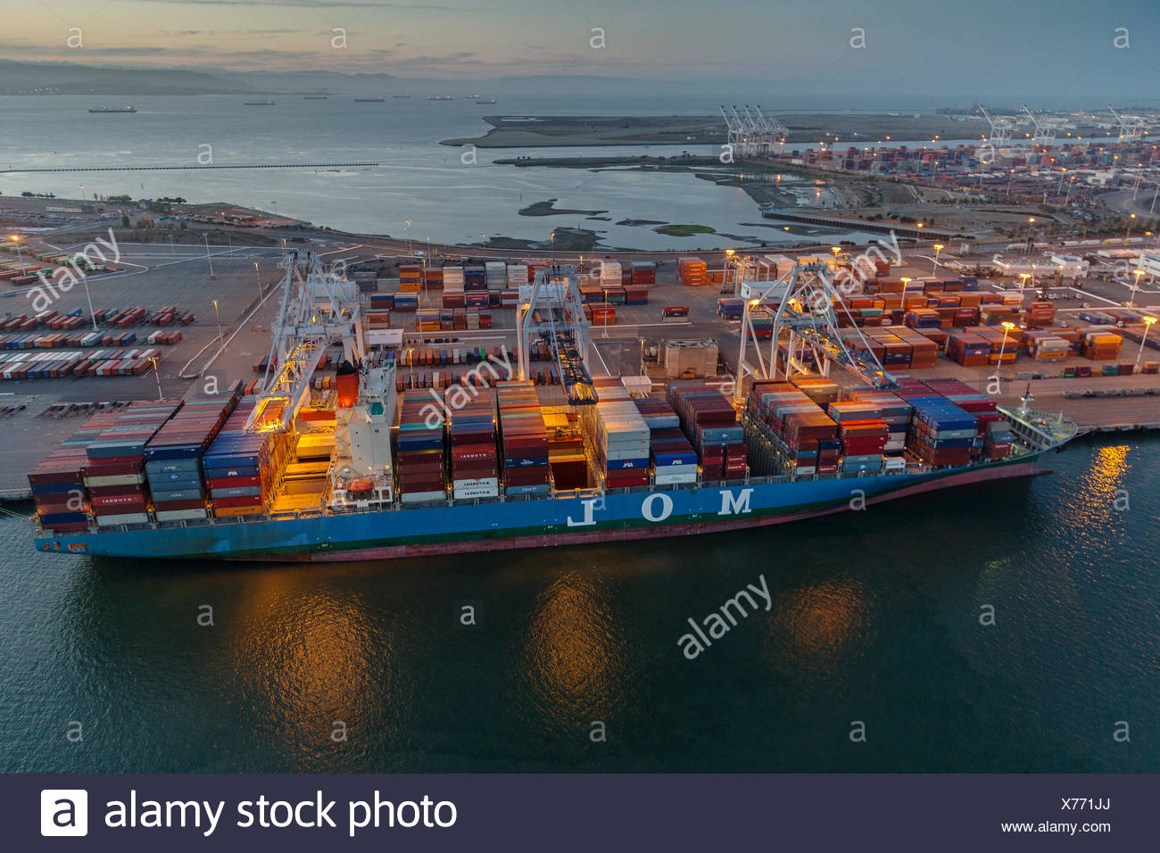 commercial dock with container ship at sunset,Oakland,California,USA - Stock Image