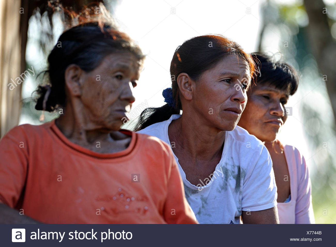 Three women with worried facial expressions, in a community of Guarani Indians, Jaguary, Caaguazú Department, Paraguay - Stock Image