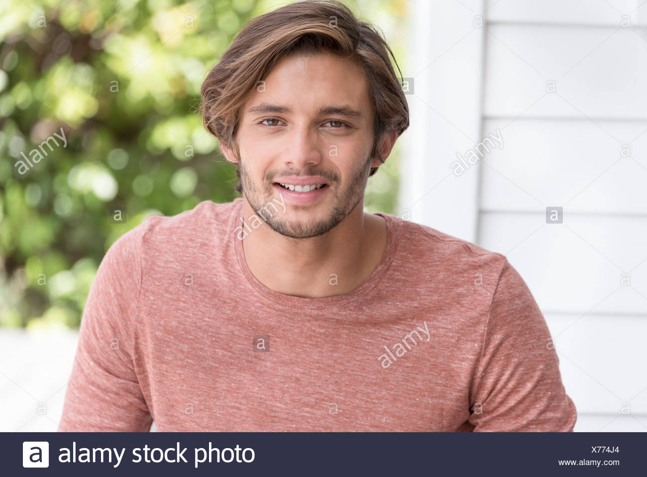 Portrait of a happy young man smiling Stock Photo