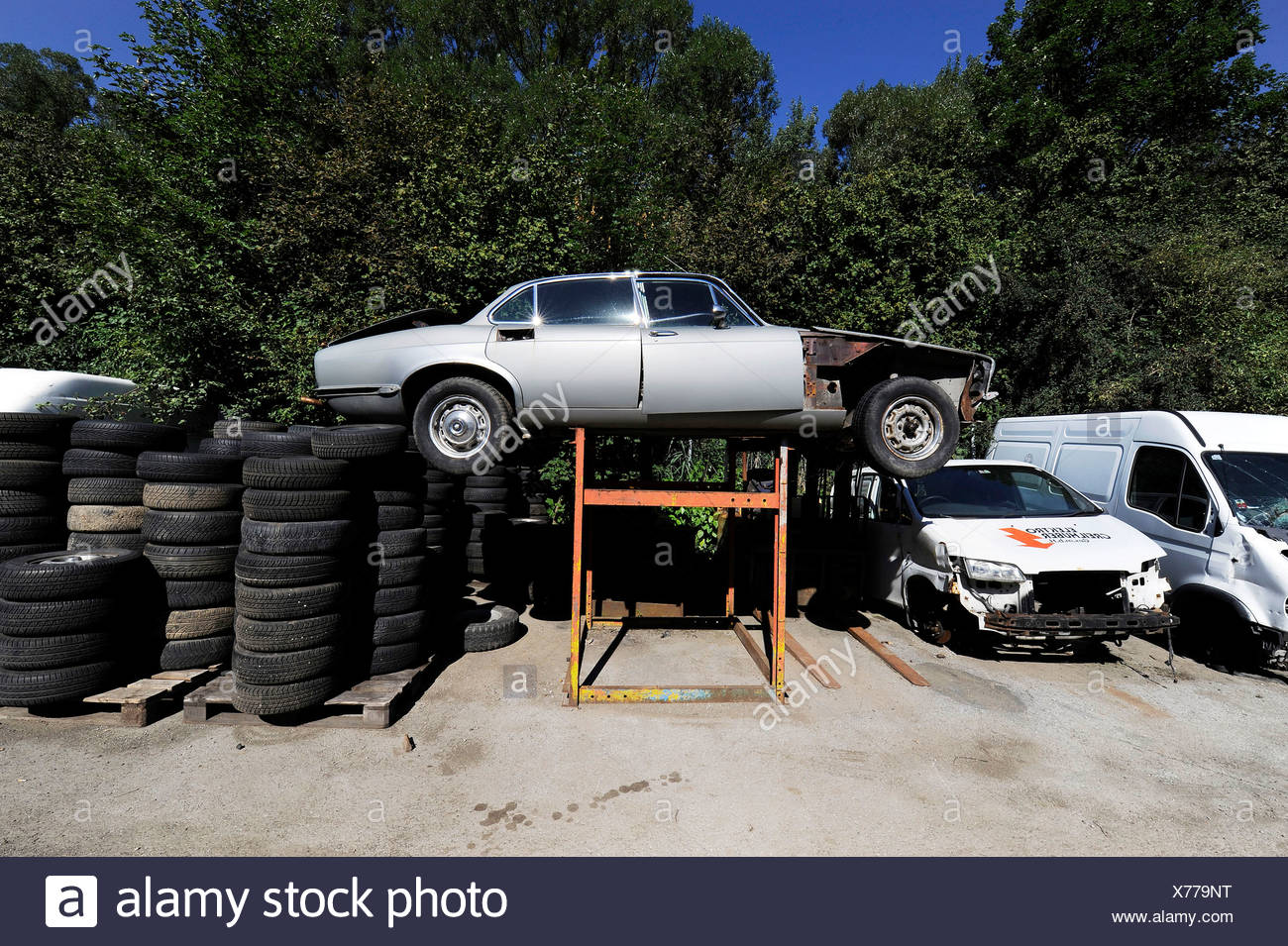 Wrecked cars and tyres in a junkyard, car recycling Stock Photo ...