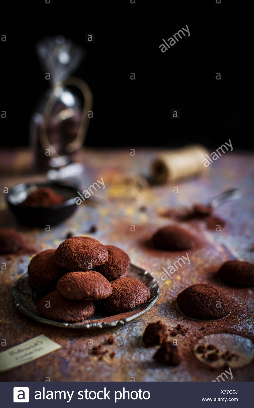 Little buttery, crumbly, eggless cookies, dusted with cocoa powder that look like small chocolate truffles. - Stock Image