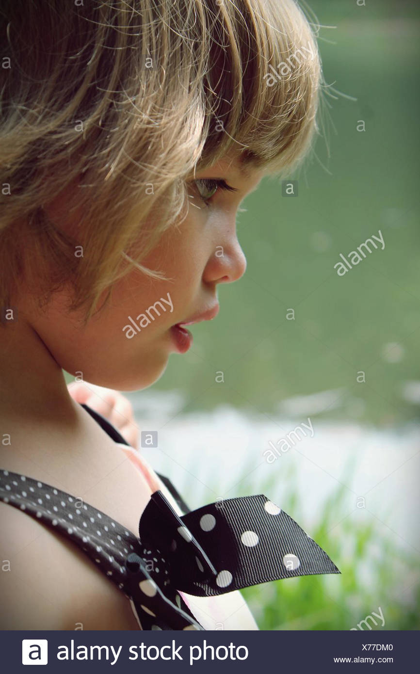 Close-up of little girl - Stock Image