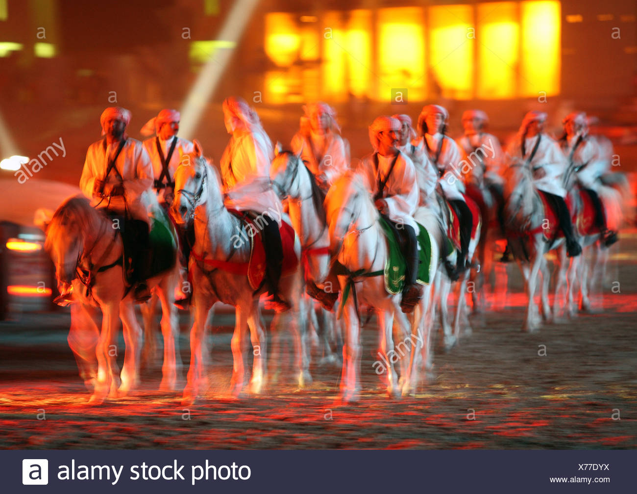 Riders in national clothing on thoroughbreds, Dubai, United Arab Emirates - Stock Image