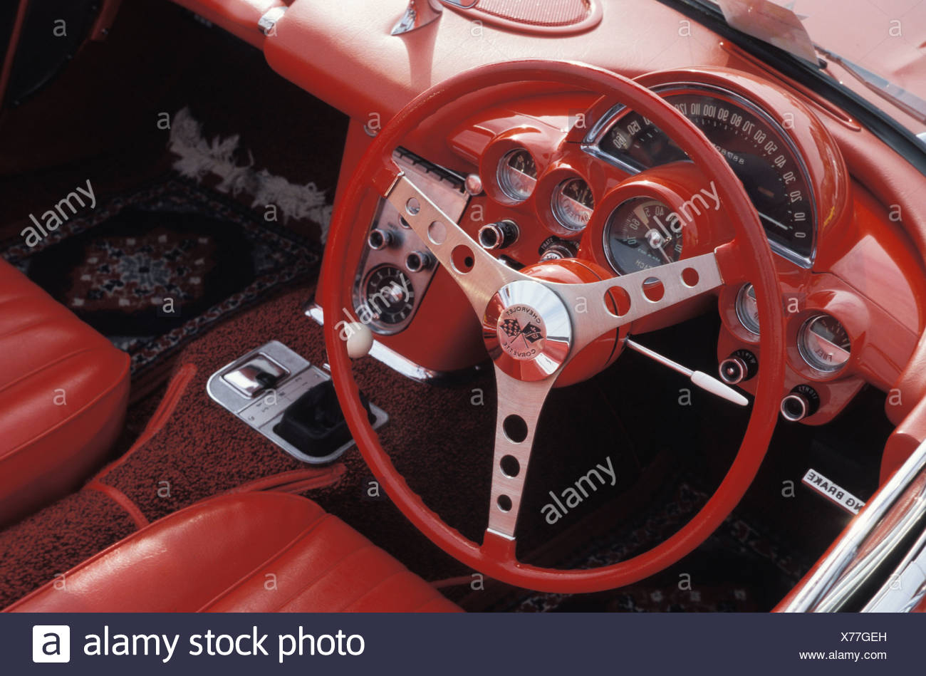 red steering wheel of a Corvette Oldtimers - Stock Image