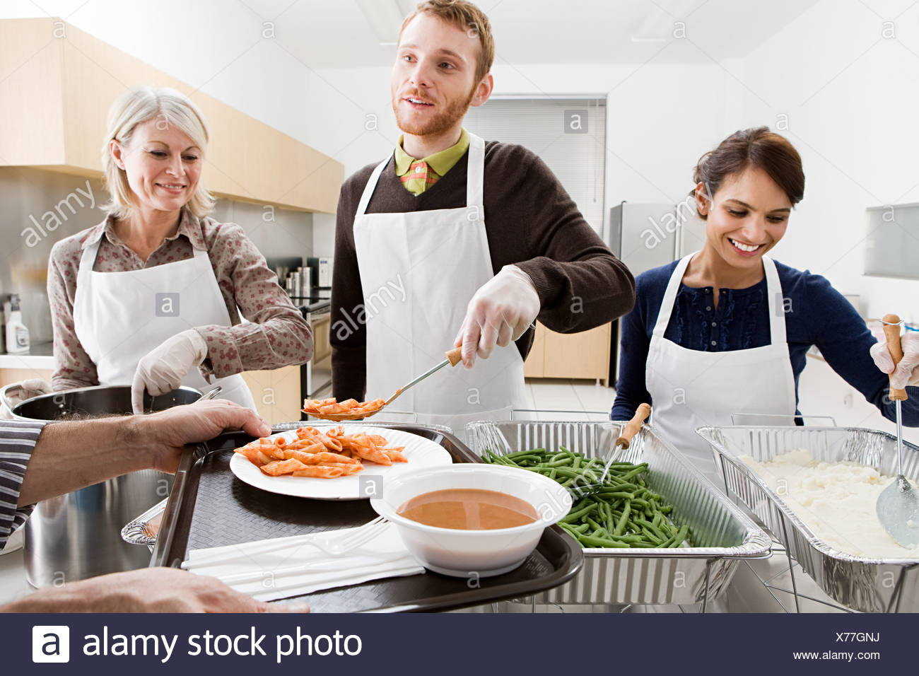 People Volunteering At Soup Kitchen Stock Photo: 279835294 ...