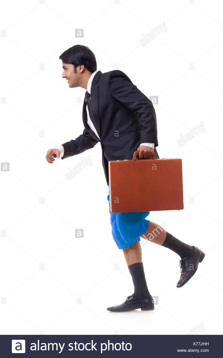 Side view of businessman walking - Stock Image