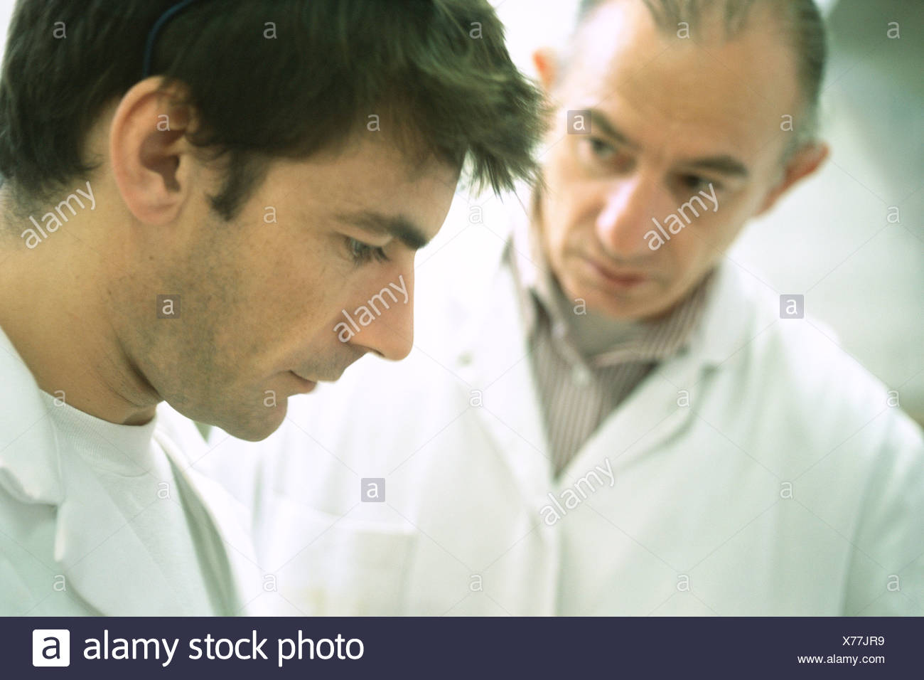 Worker and apprentice - Stock Image