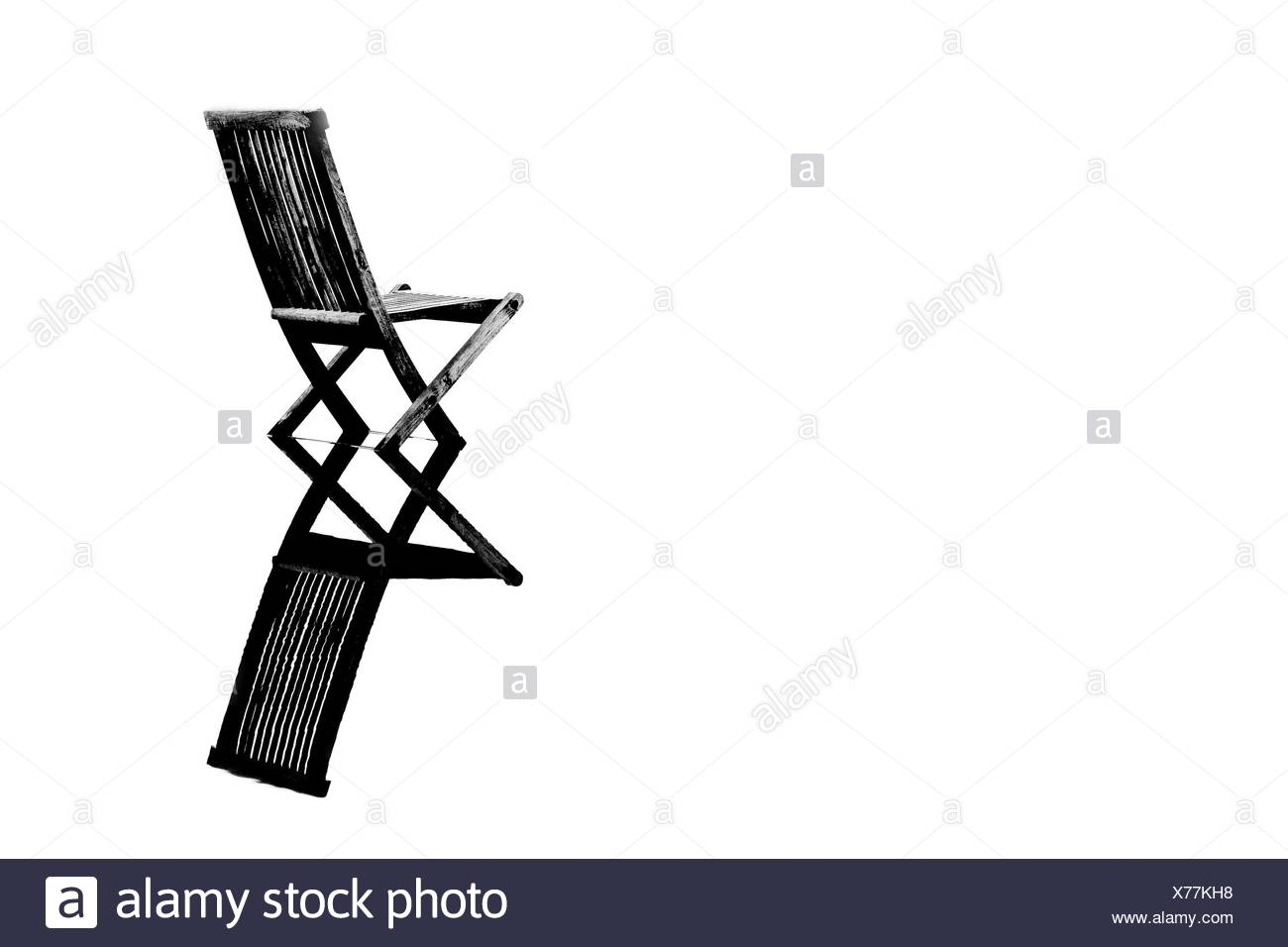 Old chair in calm water - Stock Image