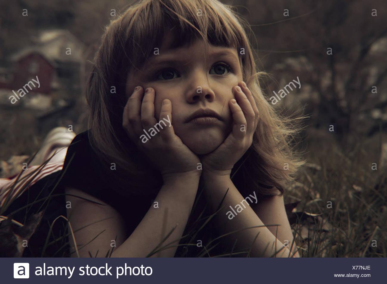 Girl lying in meadow - Stock Image