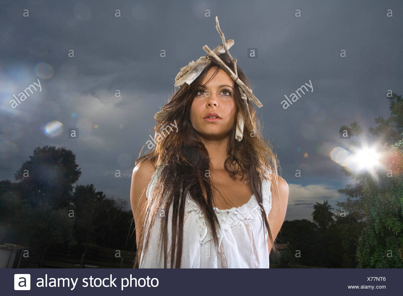 Woman with head ornament outside - Stock Image