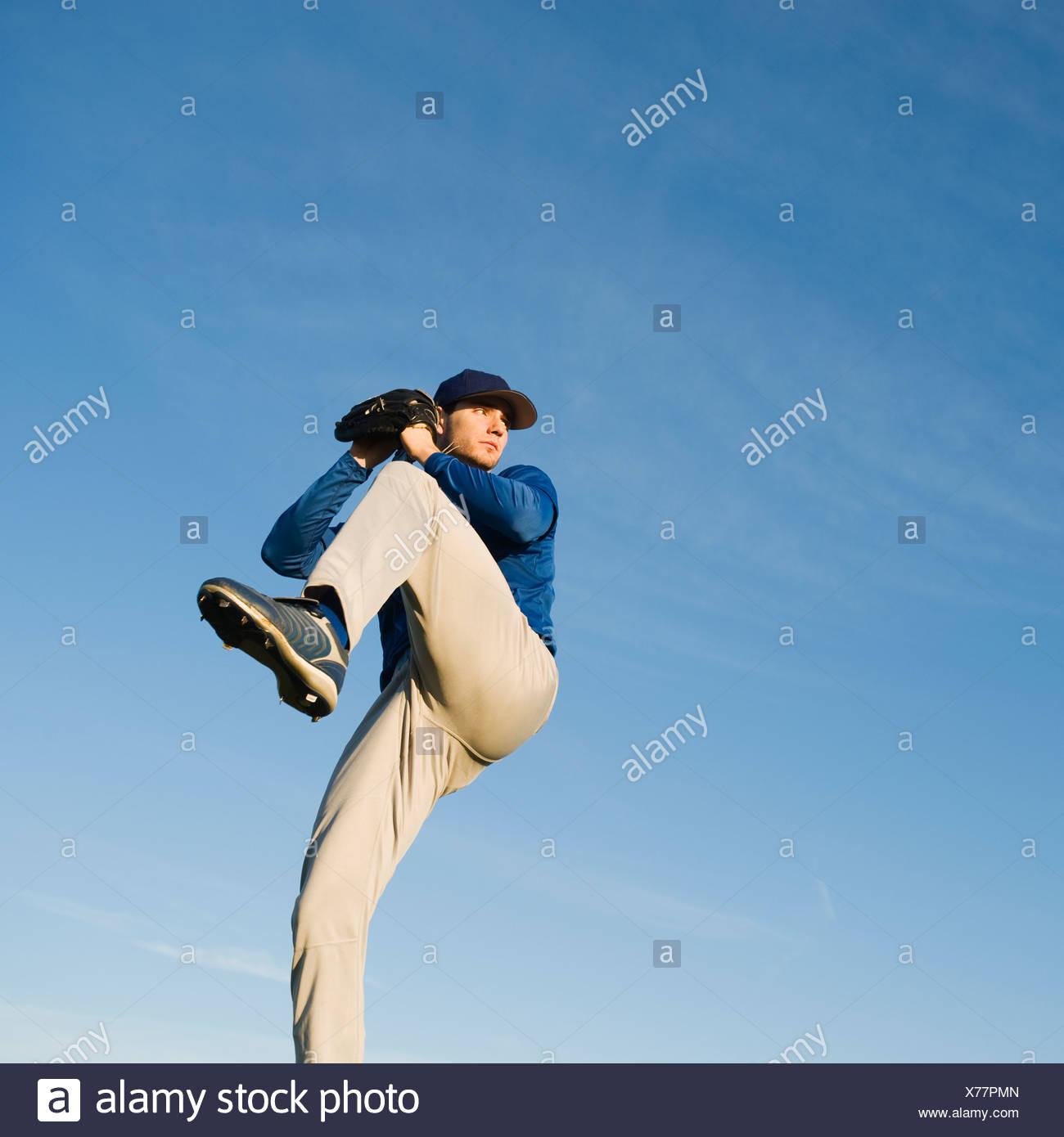 Baseball player throwing ball - Stock Image
