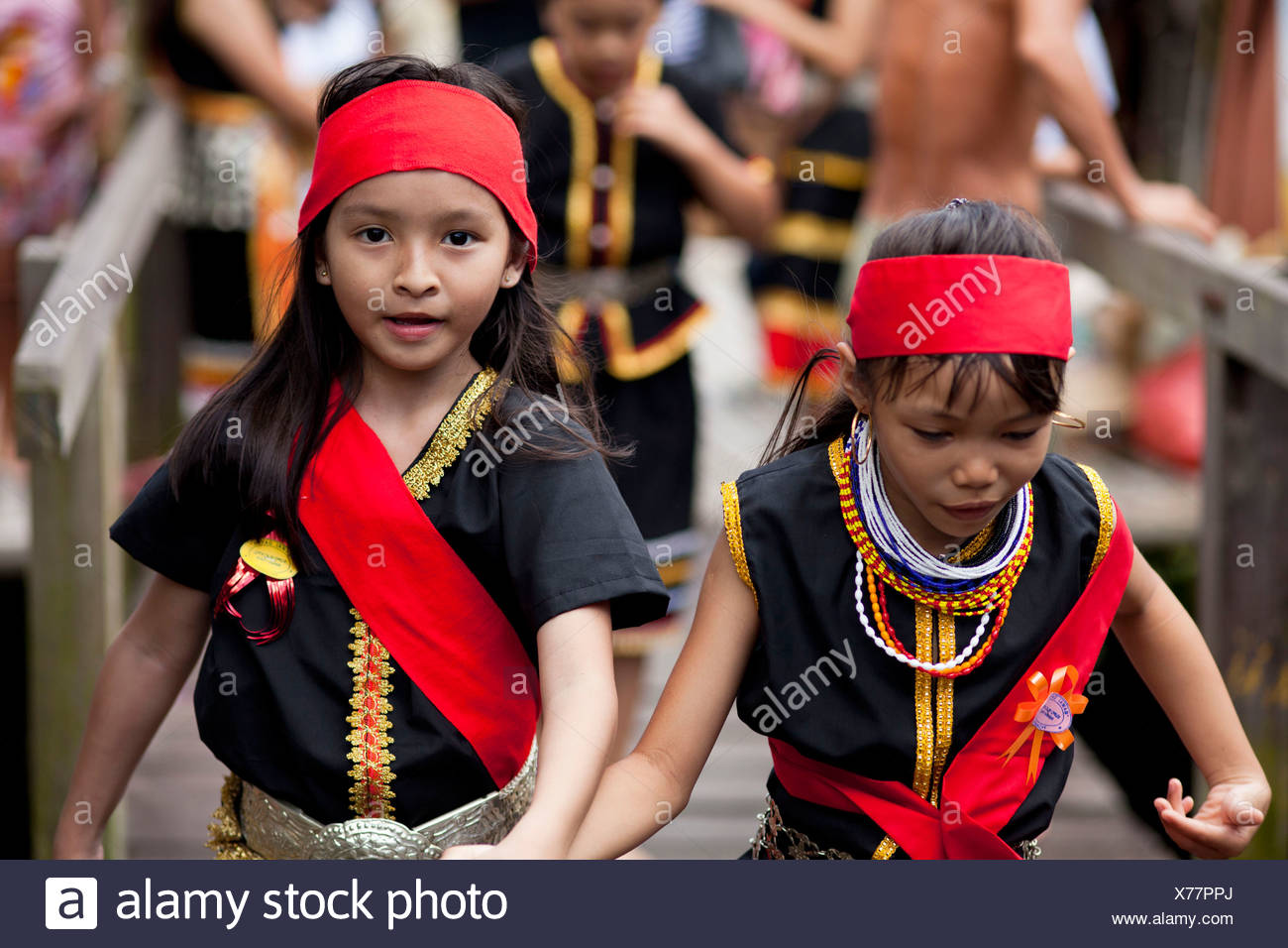 Young Bidayuh Girls In Traditional Costumes Running Around Anna Rais Long House During Selamat Gawai Harvest Festival Stock Photo Alamy