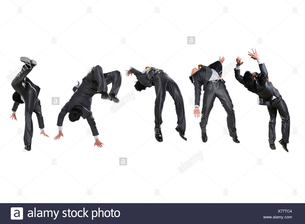 Five businessmen flipping in the air - Stock Image