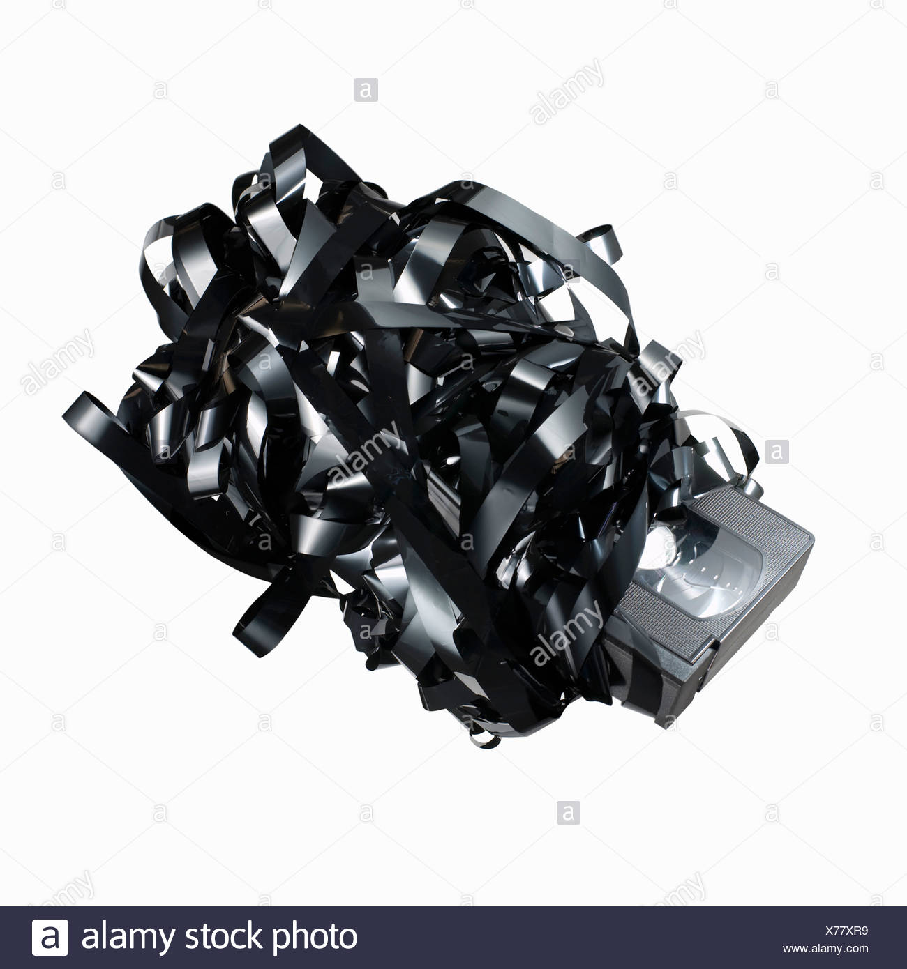 Tangled tape with VHS cassette - Stock Image