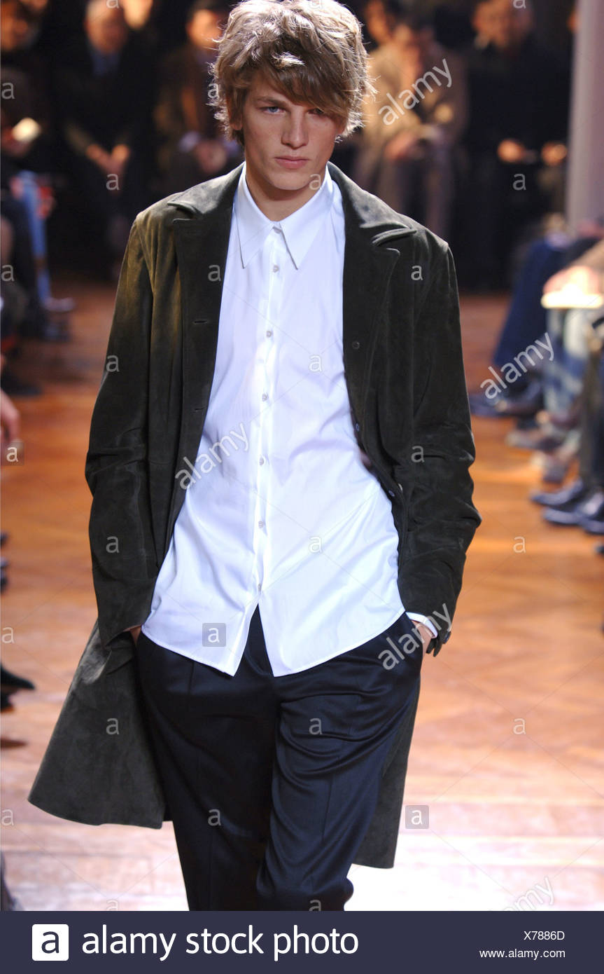 b40b1e5c Miu Miu Menswear Milan A W Blonde male wearing a white button down shirt  untucked under a