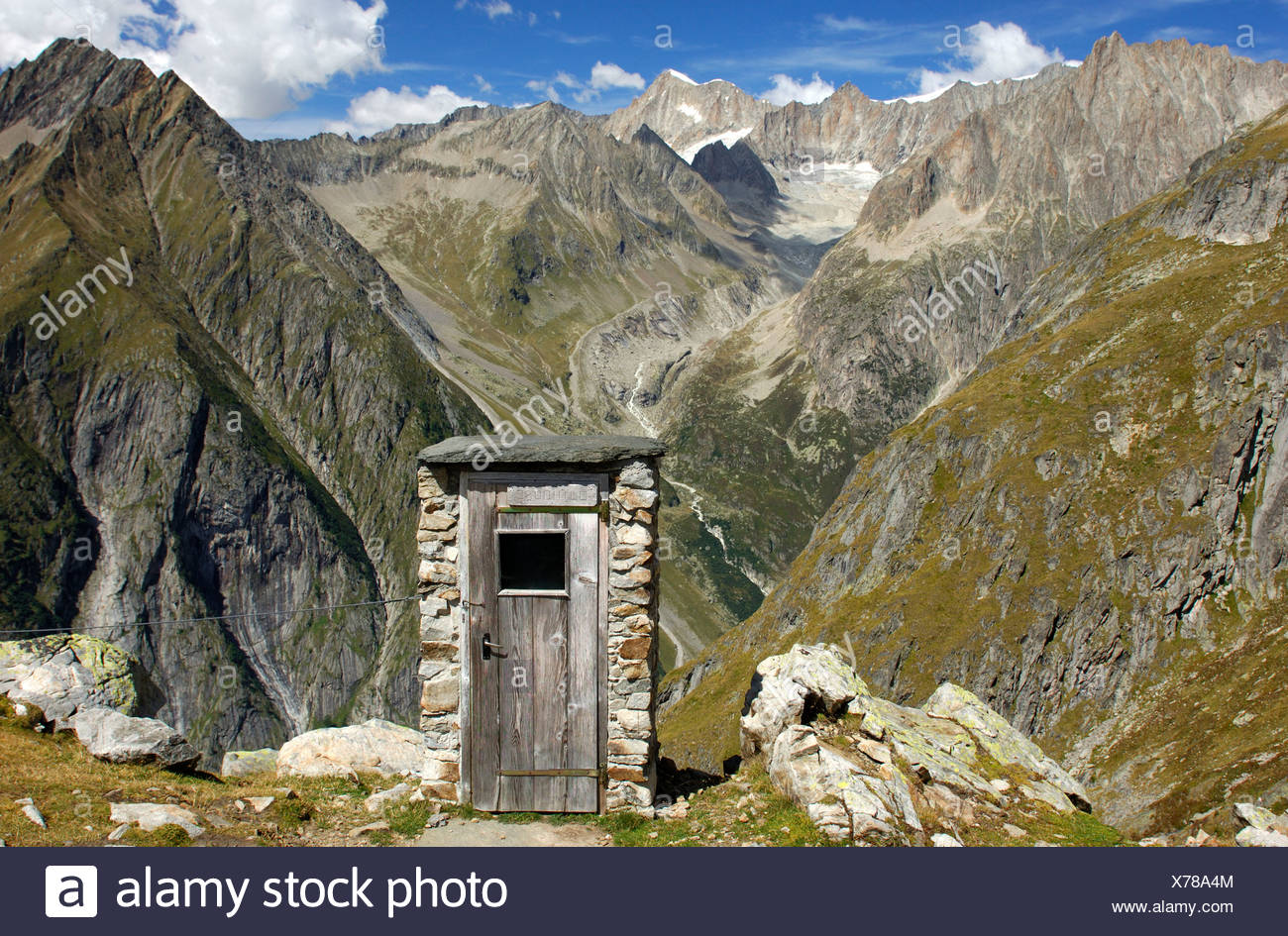 Toilet house with the best view in the Swiss Alps, Wiwanni Hut, Ausserberg Mountain, Valais, Switzerland, Europe - Stock Image