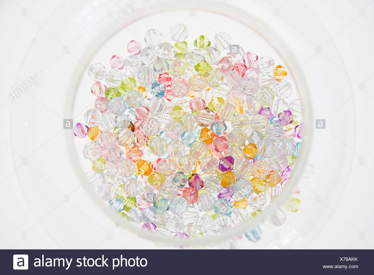 A selection of colored beads in a jar - Stock Image