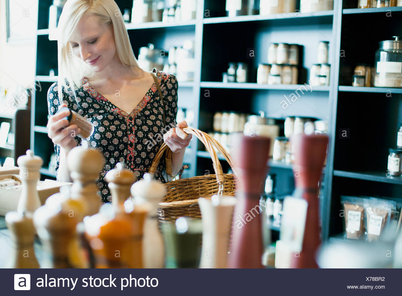 customer browsing in retail spice store - Stock Image