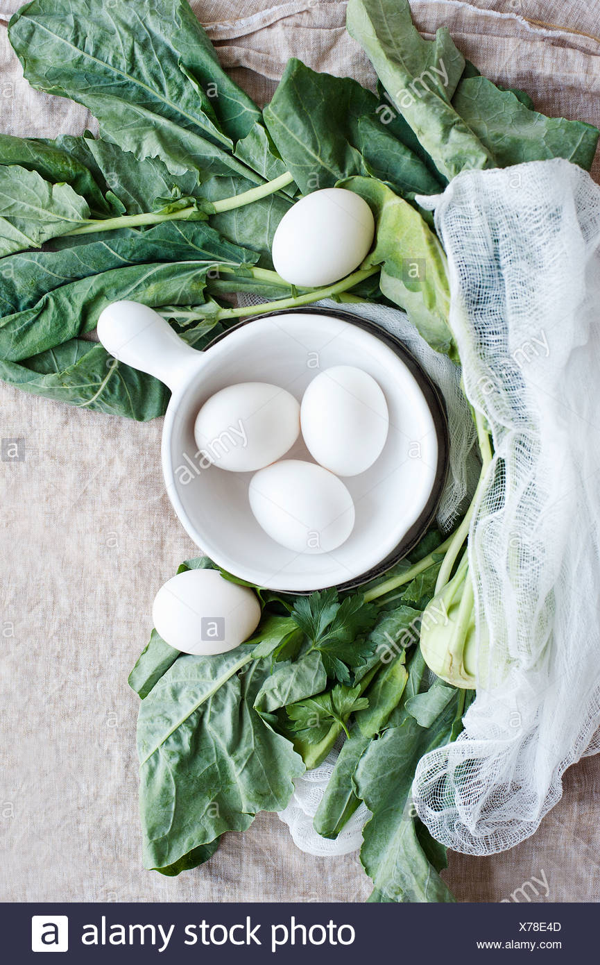 Eggs, greens and muslin cloth - Stock Image