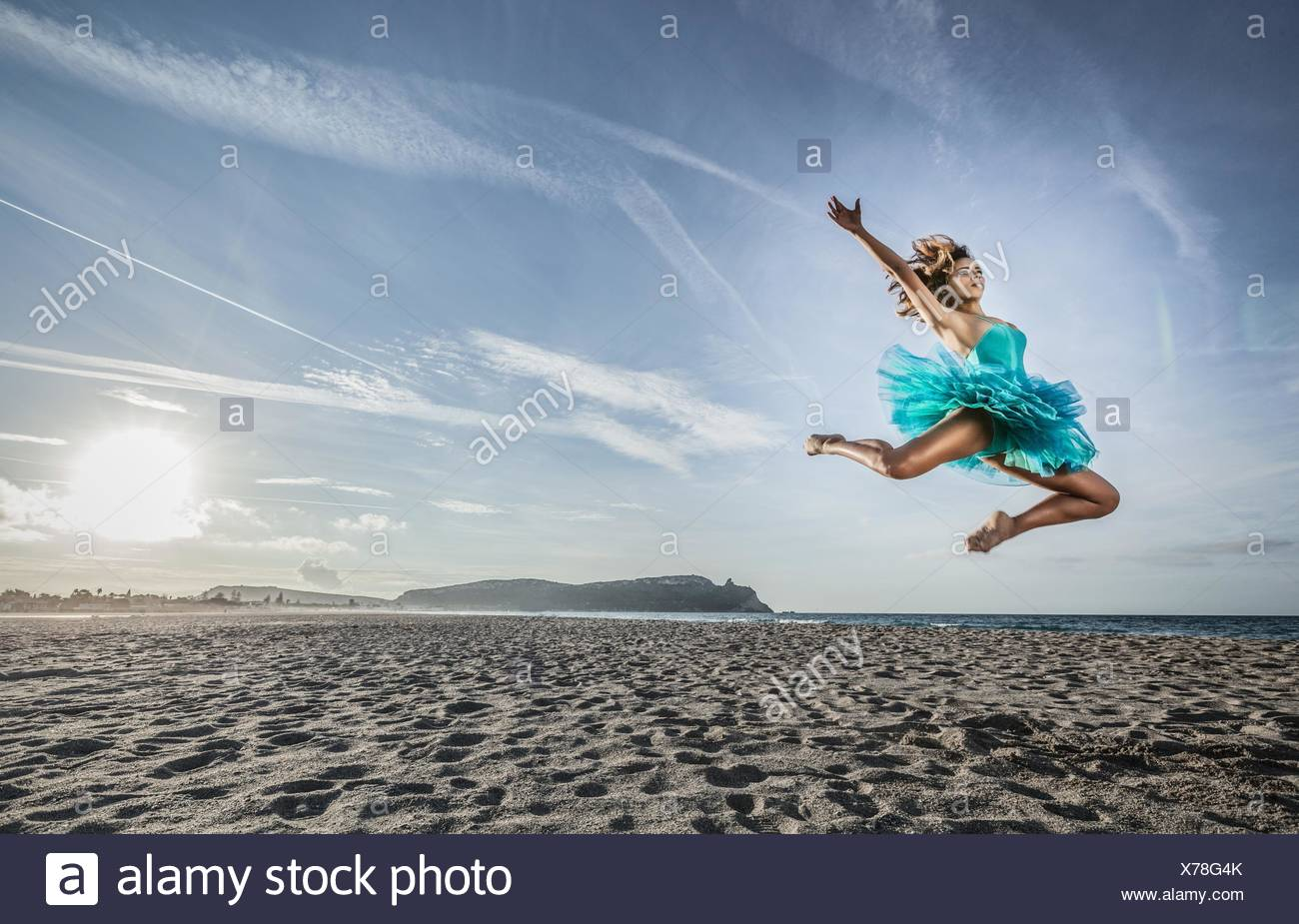 Young female dancer leaping, in mid air, Cagliari, Sardinia, Italy - Stock Image