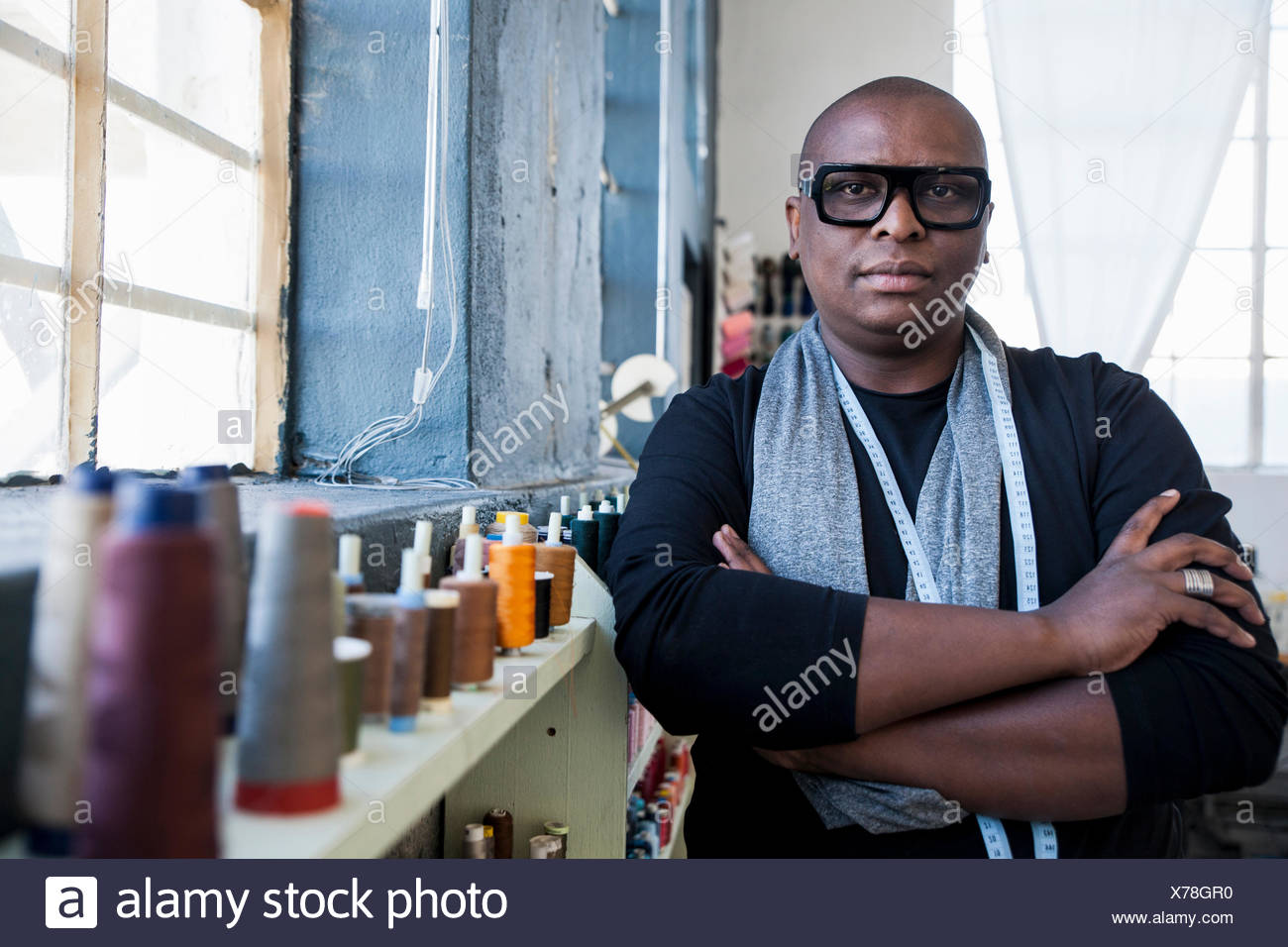 Portrait of man arms with crossed looking at camera - Stock Image