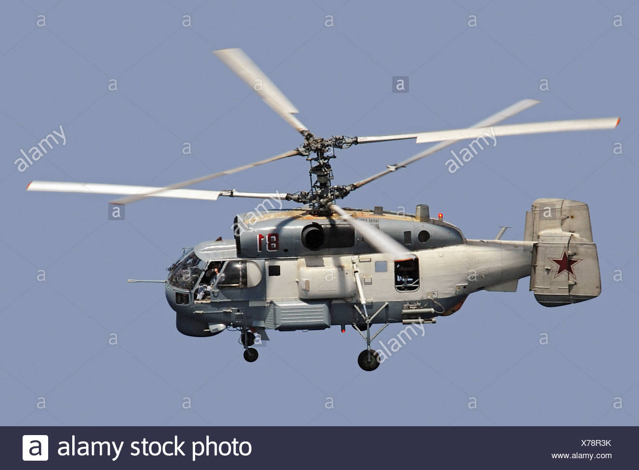 Russian Helicopter Photographed Guided-Missile Cruiser USS Vella Gulf - Stock Image