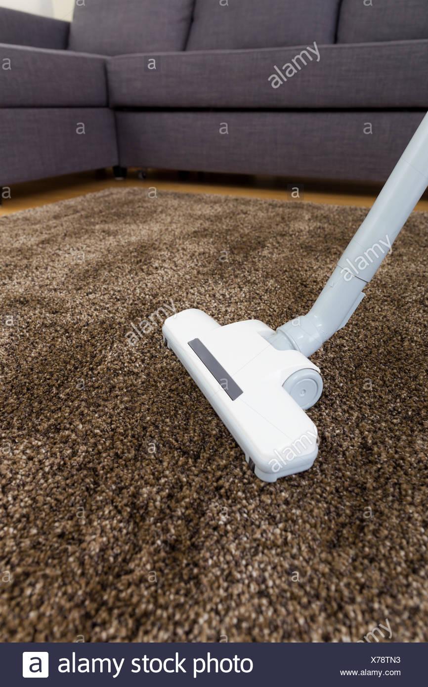 Vacuum cleaner on carpet - Stock Image