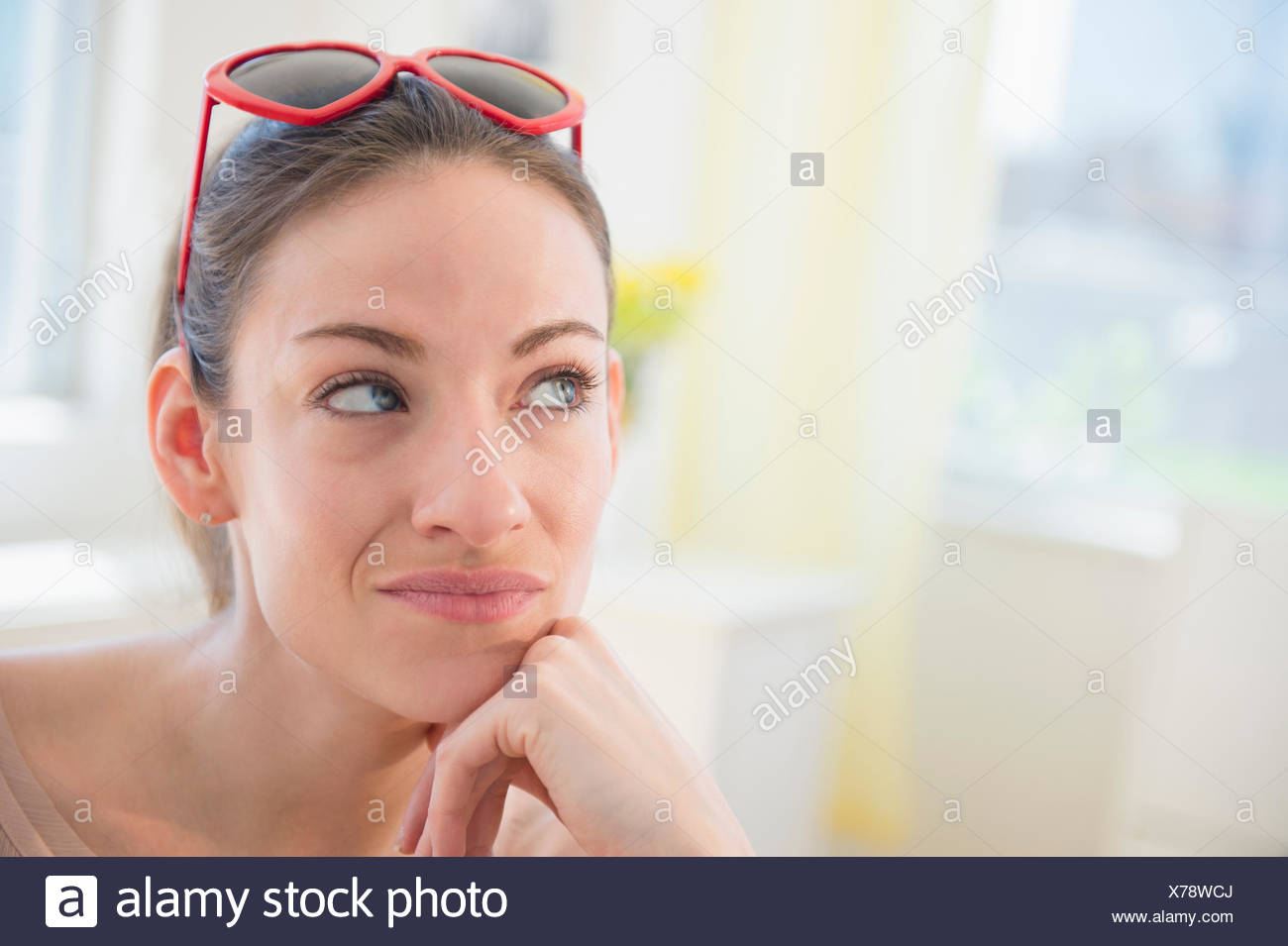 Woman at home contemplating - Stock Image