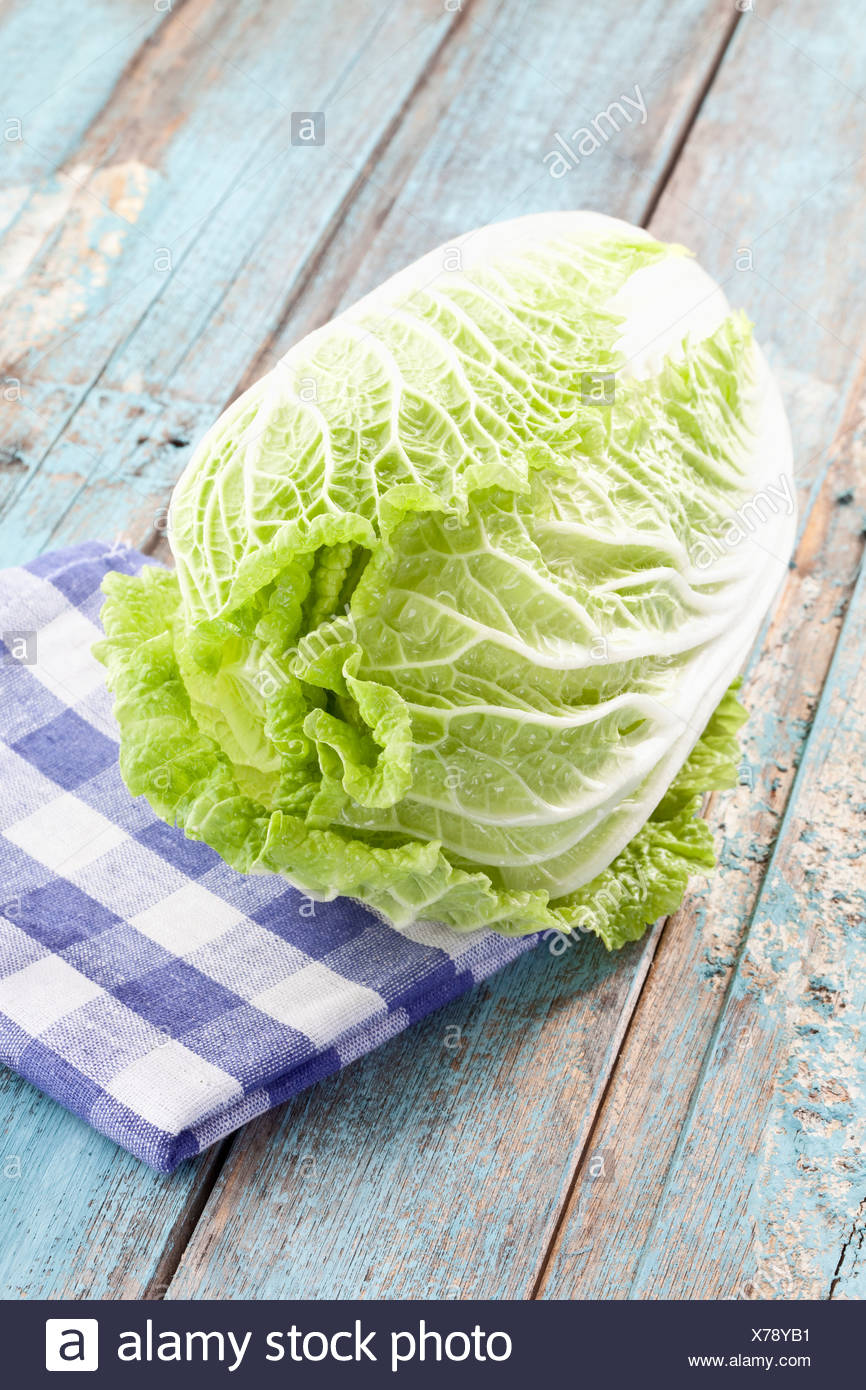 Close up of chinese cabbage on checked napkin - Stock Image
