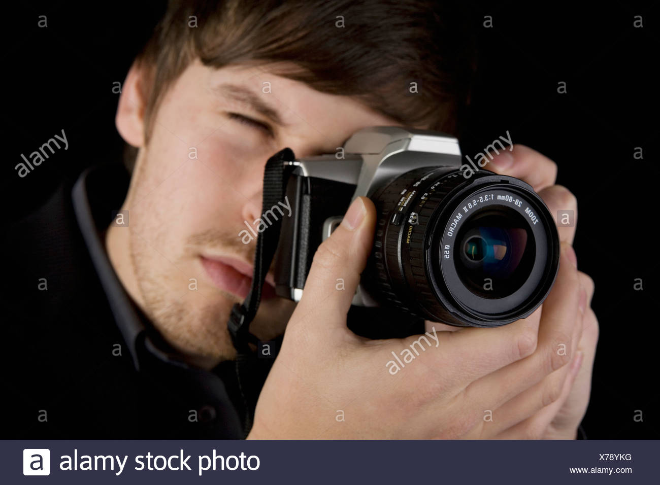 A man taking a photograph - Stock Image