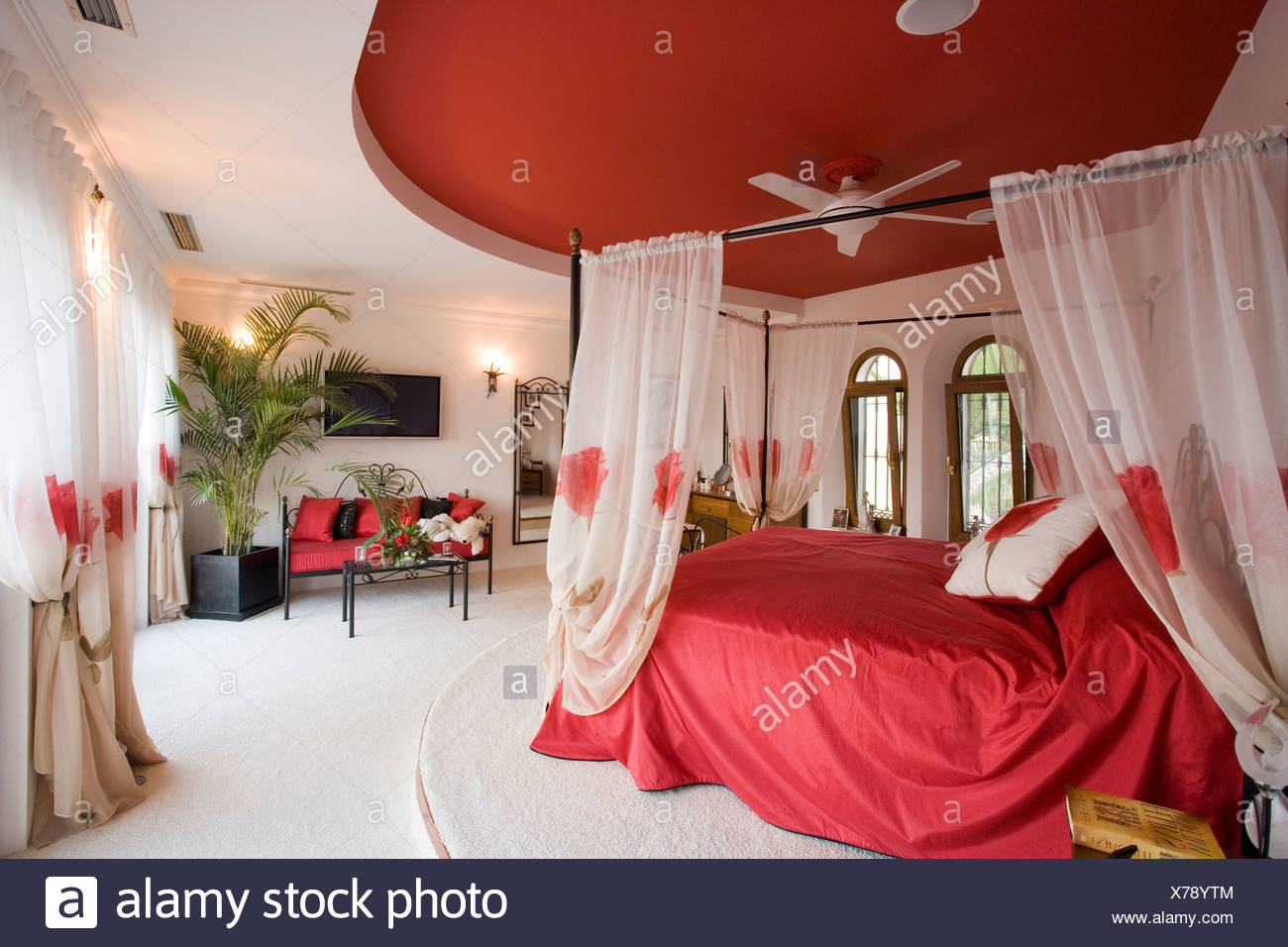 Red Ceiling Above Bed With White Voile Drapes And Red Bedlinen In Bedroom With White Carpet Stock Photo Alamy