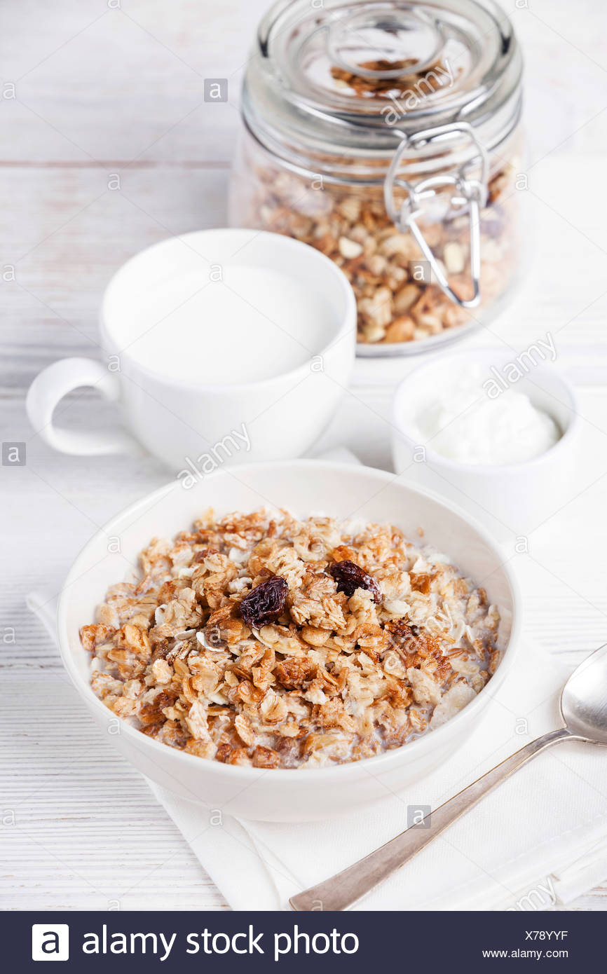 Muesli granola with raisin in wooden bowl - Stock Image