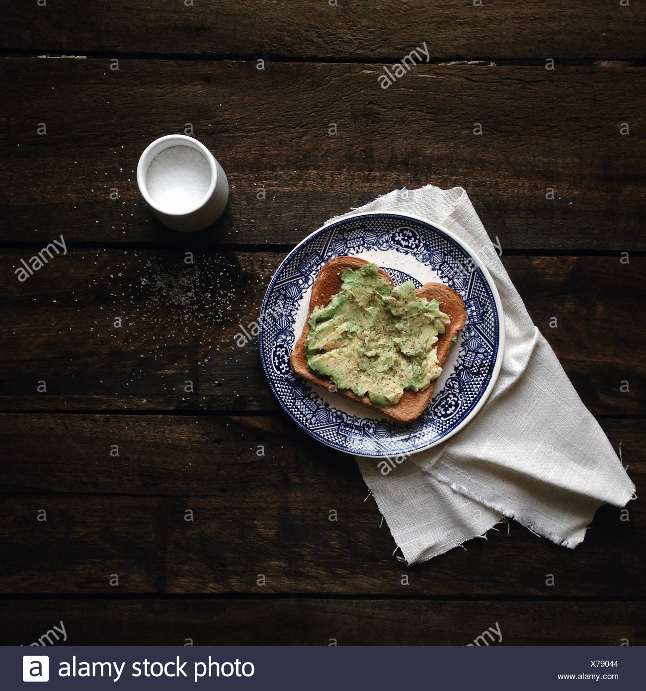 Avocado on toast with salt - Stock Image