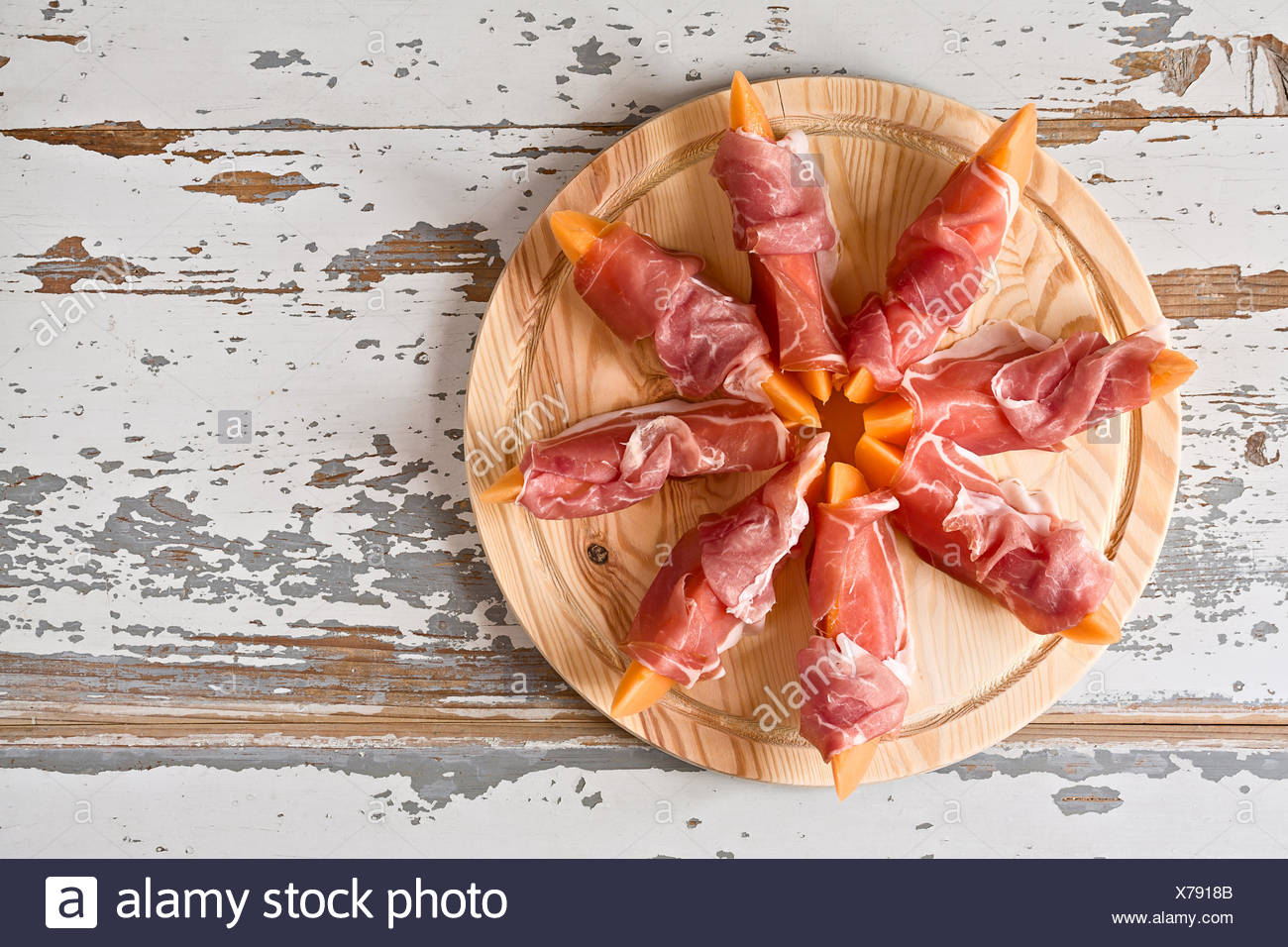 Italian food with prosciutto and melon - Stock Image