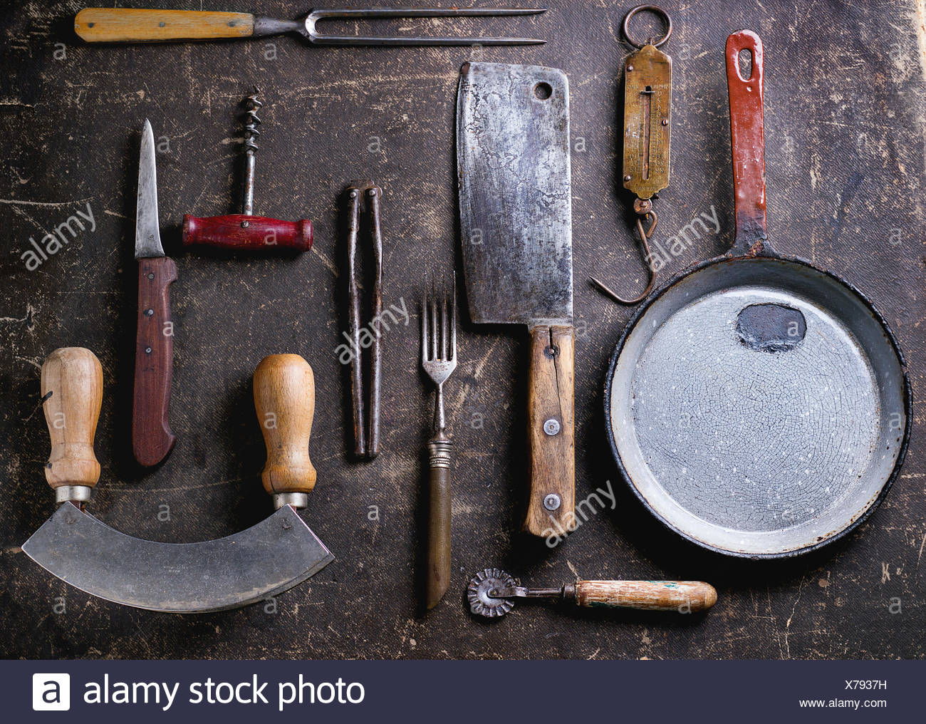Set of vintage cookware over dark background. Top view - Stock Image