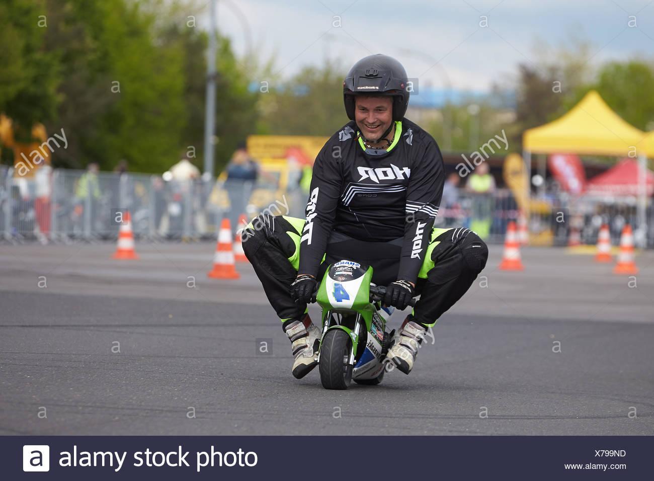 Motorcycle stuntman Mike Auffenberg on a minibike during the ADAC motorbike startup day, Koblenz, Rhineland-Palatinate, Germany - Stock Image