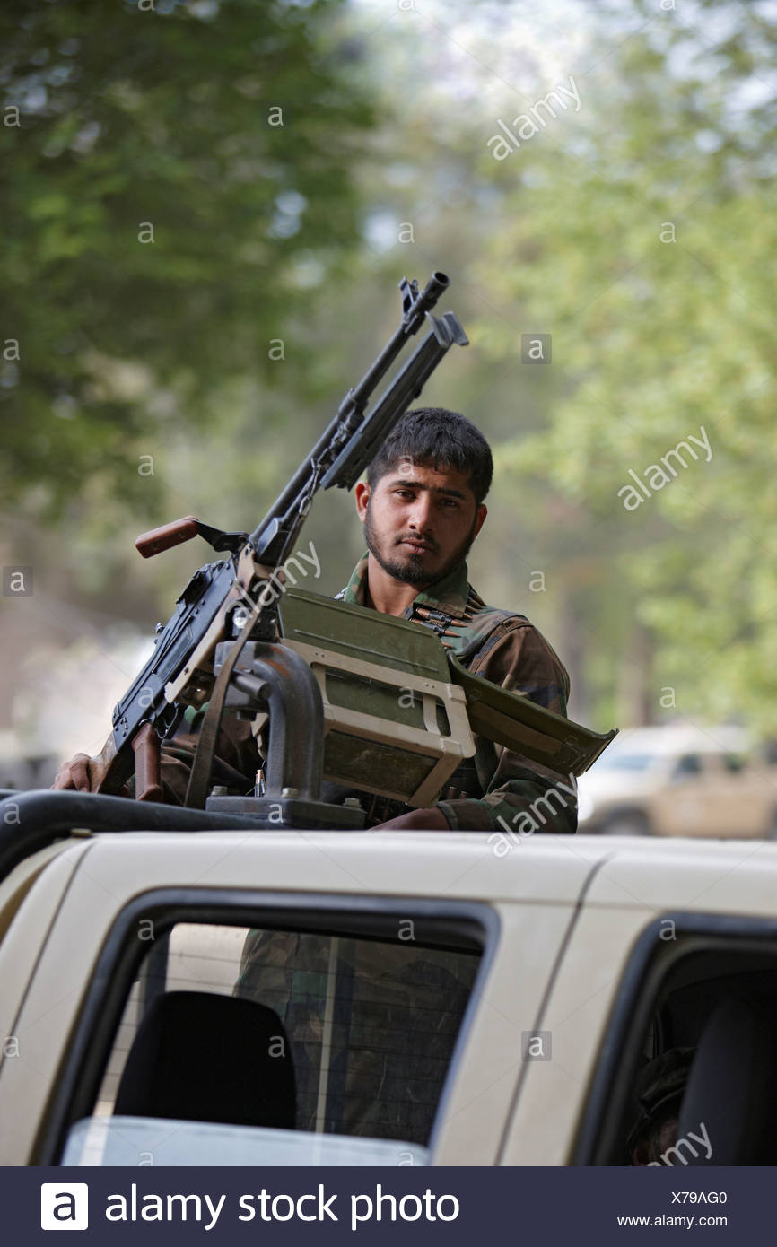 Afghan National Army Soldier Behind PK Light Machine Gun - Stock Image